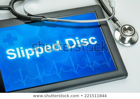 tablet with the text slipped disc on the display stock photo © zerbor