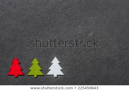 Slate board with three felt christmas trees Stock photo © Zerbor