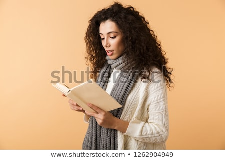 beautiful fascinating woman reading a book Stock photo © Giulio_Fornasar
