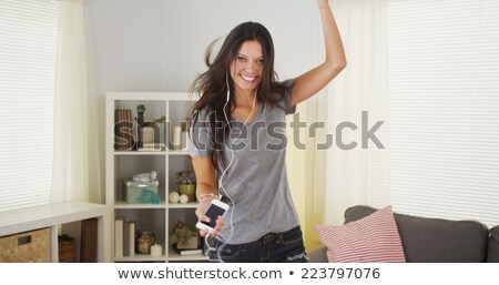 girl singing and laughing in her living room stock photo © Giulio_Fornasar