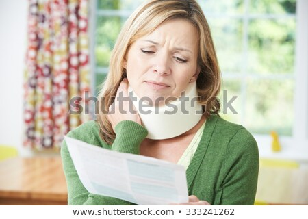 Woman Reading Letter After Receiving Neck Injury Stock photo © HighwayStarz