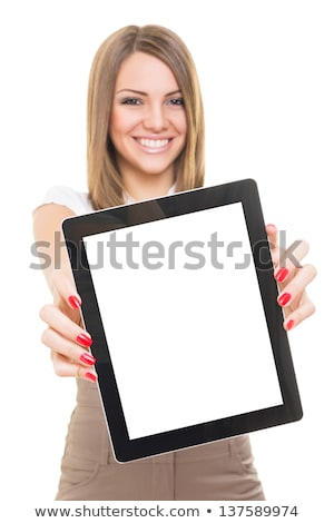 young smiling woman showing blank tablet computer screen in office focus on tablet computer stock photo © deandrobot
