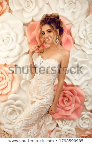 Blond slim woman over the flower wall Stock photo © konradbak