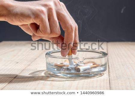 Asbak geld geïsoleerd witte euro sigaret Stockfoto © fuzzbones0