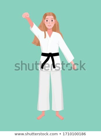 Attractive woman standing in defence stance Stock photo © deandrobot