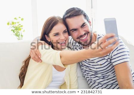 Aranyos pár elvesz kanapé otthon nappali Stock fotó © wavebreak_media