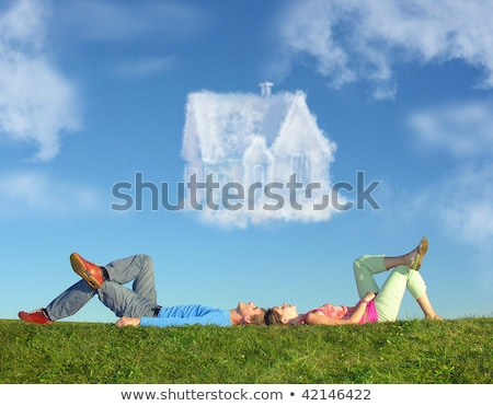 Stock photo: lying couple on grass and dream house collage