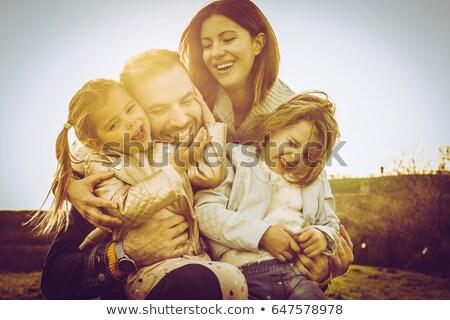Stok fotoğraf: Aile · kız · park · bebek · yüz · kadın