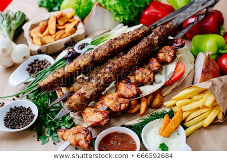shish kebab and potatoes stock photo © digifoodstock