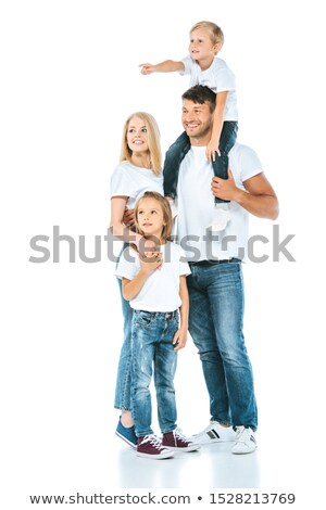 father and mother stand holding children on the shoulders stock photo © paha_l