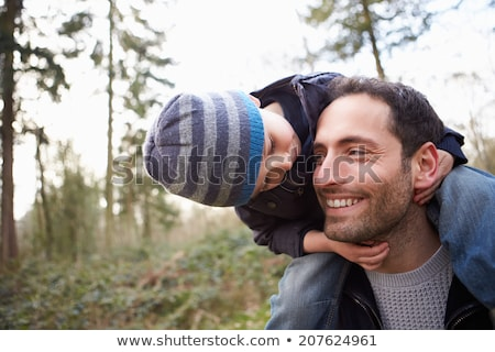 father with child on shoulders in winter Stock photo © Paha_L