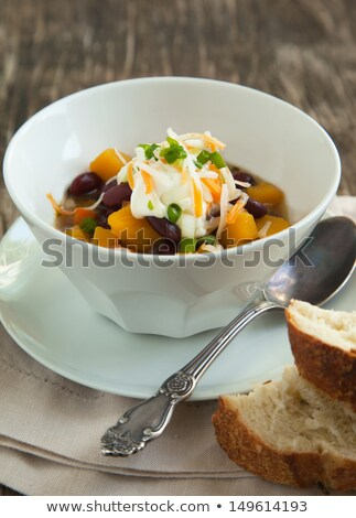 Bowl of black bean soup garnished with cheese Stock photo © ozgur