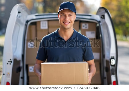 smiling delivery man Stock photo © tiero
