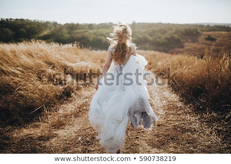 beautiful young bride in wedding dress and flower wreath stock photo © deandrobot