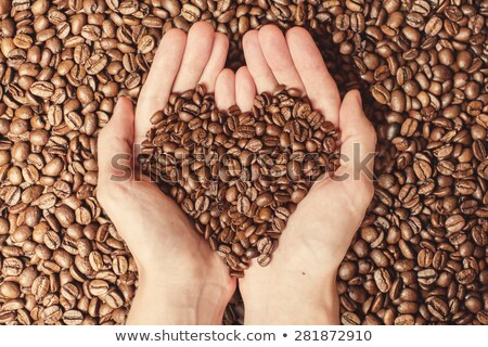 Handful of roasted coffee beans heart shaped pile Stock photo © stevanovicigor