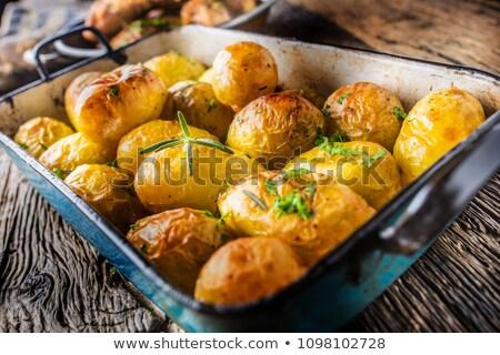 Aardappel bijgerecht spek kaas plantaardige raket Stockfoto © Digifoodstock