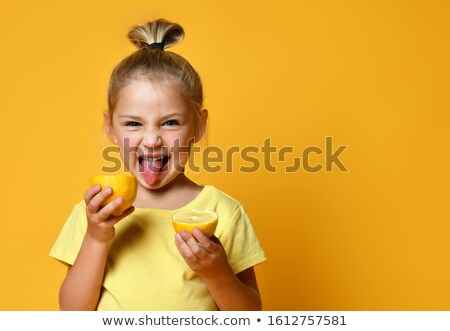 Smiling casual girl showing tongue Stock photo © deandrobot