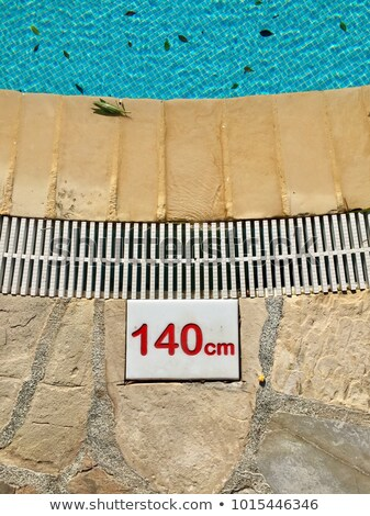 Signs for show the depth of the swimming pool Stock photo © Boophuket