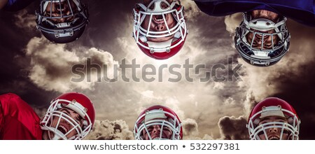 Foto stock: Composite Image Of American Football Huddle