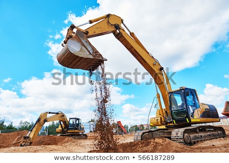 Excavator working on house construction site Stock photo © bluering