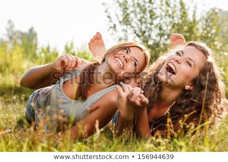 Iki genç dostluk mutlu insanlar Stok fotoğraf © Aikon