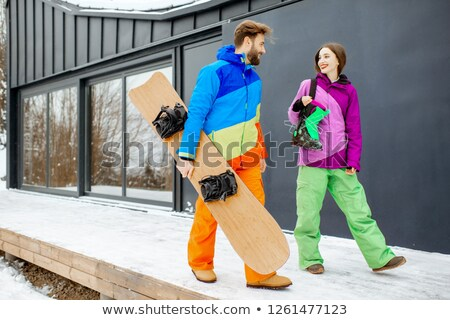 Young woman walking with snowboard Stock photo © dash