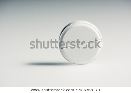 Close-up view of round white medical tablets on grey, medicine and healthcare concept     Stock photo © LightFieldStudios