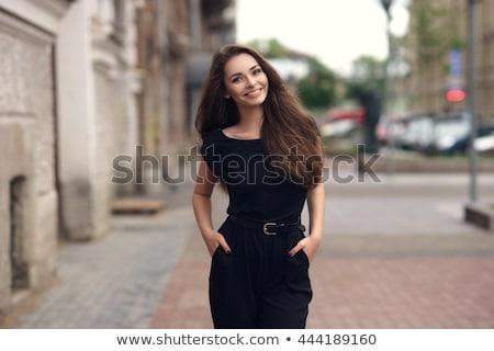 portret · mooie · vrouw · weinig · zwarte · jurk · glimlachend · jonge · vrouw - stockfoto © deandrobot