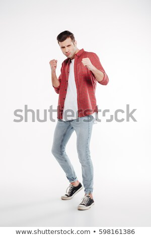 Vertical image of Cool man showing his fists Stock photo © deandrobot