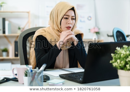 Pensive female with laptop working  Stock photo © dash