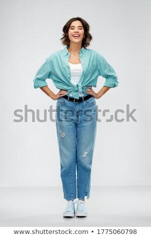 Shot vrolijk jonge vrouw roze jas Stockfoto © deandrobot