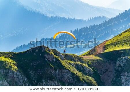 Siklórepülés hegyek verekedés extrém sport tevékenység természet Stock fotó © olira
