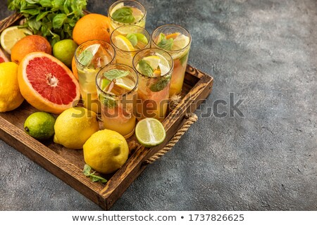 Stock photo: Lemonade with lemon, orange and grapefruit