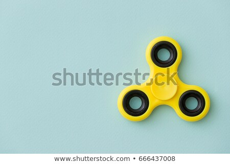 Yellow fidget spinner in male hand Stock photo © stevanovicigor