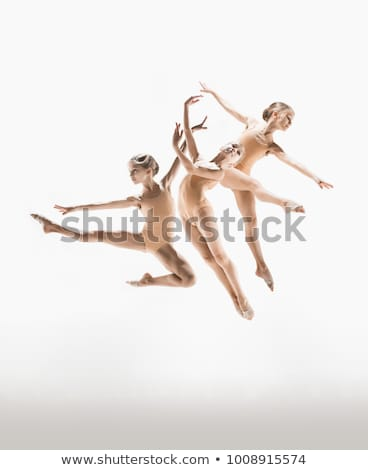 young modern ballet dancer jumping on white background stock photo © julenochek