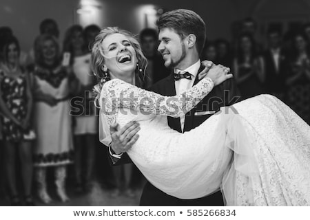 Stock photo: beautiful bride and groom dancing