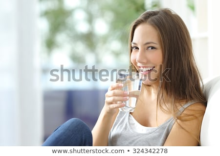 Stock fotó: Pretty Young Lady With A Glass Of Mineral Water
