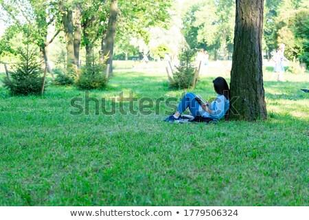Genç kız oturma ağaç orman genç kız Stok fotoğraf © andreonegin
