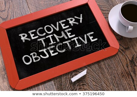 recovery time objective handwritten by white chalk on a blackboard stock photo © tashatuvango