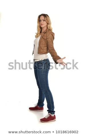 Full length portrait of a woman standing with outstretched hands Stock photo © deandrobot