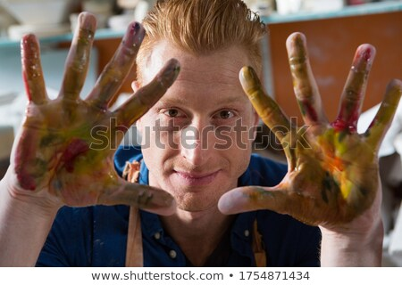 Male potter showing his painted hands Stock photo © wavebreak_media