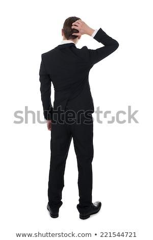 Young caucasian businessman scratching head. Stock photo © RAStudio