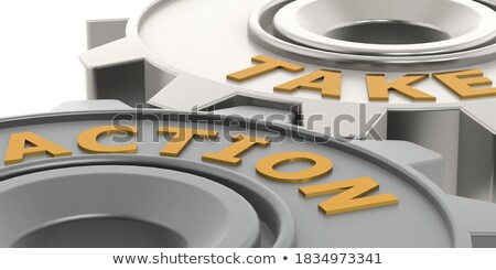take action on the golden metallic gears stock photo © tashatuvango