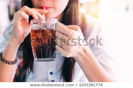 asian woman with soda drink stock photo © lightfieldstudios