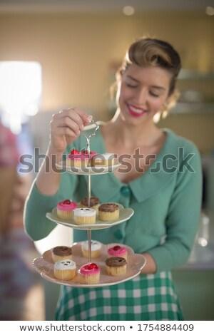 Waitress holding tray of muffins in restaurant Stock photo © wavebreak_media