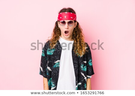 Young caucasian angry hippie man screaming. Stock photo © RAStudio