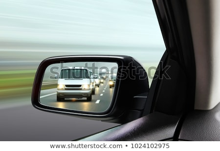 Reflection of city traffic in car side mirror Stock photo © stevanovicigor