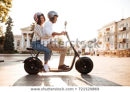 Vista lateral feliz africano casal motocicleta Foto stock © deandrobot