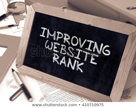 improving website rank   chalkboard with hand drawn text stock photo © tashatuvango