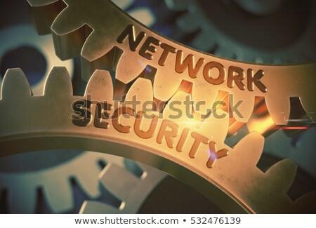 network protection concept golden metallic gears stock photo © tashatuvango